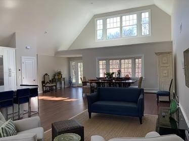 living room with large windows- Remsenberg, NY