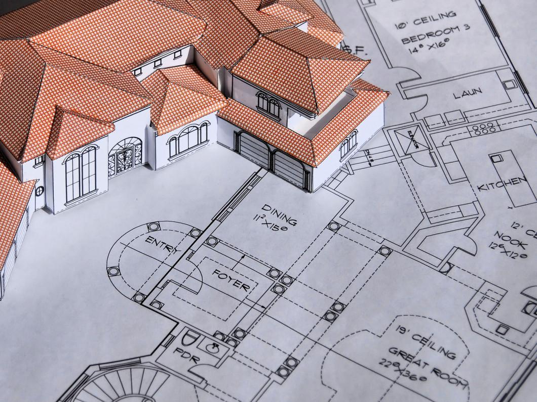 bigstock-Model-House-And-Blueprints-2165803-8b8